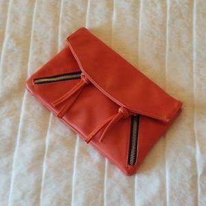 DEUX LUX // edgy orange tassel zipper clutch